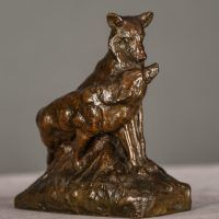 Bronze sculpture of two coyotes nuzzling each other