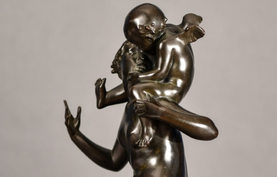 Bronze sculpture of Psyche seated with Cupid on her shoulders