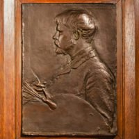 Bronze bas relief of Jules Bastian LePage with paintbrush and palette, framed