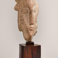 Carved head on reclaimed marble
