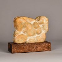 Carved marble sculpture of a reclining nude woman