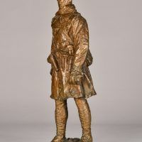 Bronze sculpture of a Canadian officer, angled view