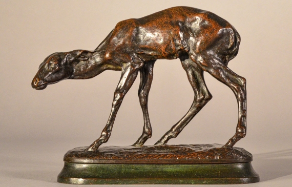 Bronze sculpture of a scared fawn, side view