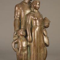 Bronze sculpture of a family with father, mother, and child, right facing view